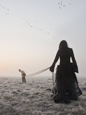 Leszek Paradowski WOMAN WITH MAN TIED BY ROPE IN FIELD Couples
