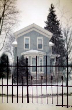 Jill Battaglia HOUSE BEHIND IRON FENCE IN SNOW Gates
