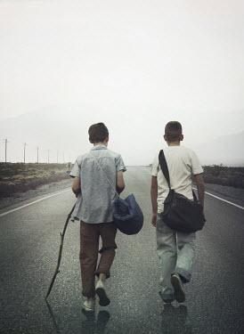 Mark Owen TWO BOYS WALKING ON COUNTRY ROAD Children