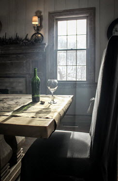 Stephen Carroll WINE BOTTLE AND GLASS ON TABLE Interiors/Rooms
