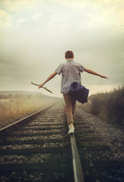 Mark Owen BOY PLAYING ON RAILWAY TRACKS Children