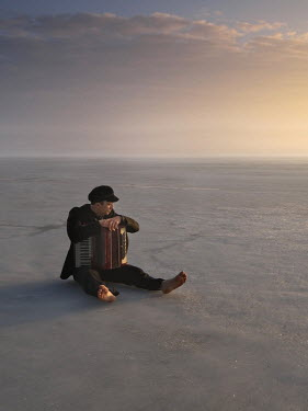 Leszek Paradowski MAN WITH ACCORDION SITTING ON ICE Men