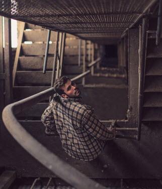 Peter Jamus Holme MAN STANDING ON METAL STAIRS Men