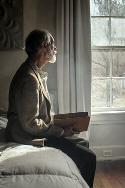 Stephen Carroll MAN ON BED WITH BOOK Old People