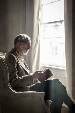 Stephen Carroll MAN IN CHAIR WITH BOOK Women