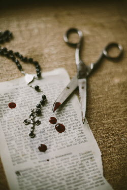 Maren Becker TORN PAGE OF BOOK WITH SCISSORS, ROSARY AND BLOOD Miscellaneous Objects