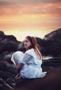 Whitney Justesen RED HAIRED GIRL ON ROCK AT SUNSET Women