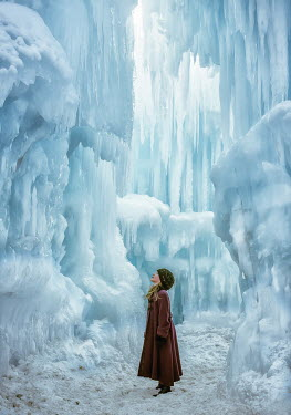 Elisabeth Ansley LITTLE GIRL STANDING IN ICE CAVE Children