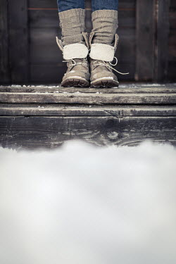 Paolo Martinez WOMAN IN BOOTS ON PORCH IN SNOW Women