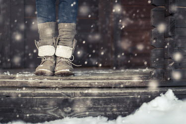 Paolo Martinez WOMAN IN BOOTS ON PORCH IN SNOW Body Detail