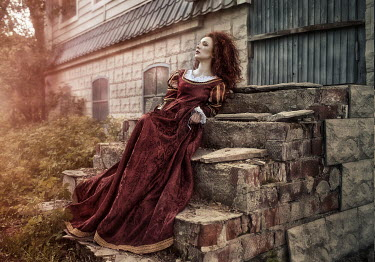 Margarita Kareva WOMAN IN VELVET GOWN ON STONE STEPS Women