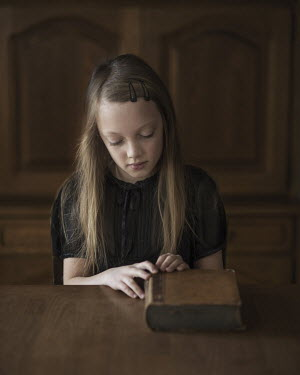 Magdalena Berny GIRL SITTING AT TABLE WITH BOOK Children