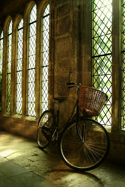 John Foley BICYCLE IN OLD CORRIDOR WITH LEADED WINDOWS Miscellaneous Transport