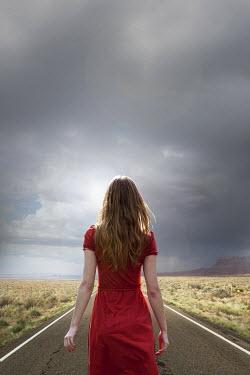 Yolande de Kort WOMAN ON COUNTY ROAD UNDER STORMY SKY Women