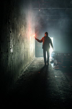 Stephen Carroll SILHOUETTE OF MAN WITH FLARE IN ALLEYWAY Men