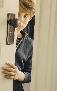 Stephen Mulcahey BOY HIDING BEHIND A DOOR Children