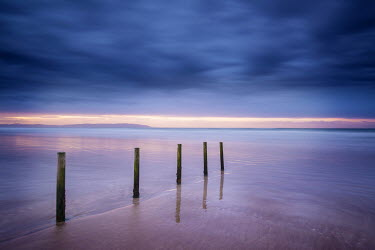 Vincent MacNamara POSTS IN CALM SEA AT SUNSET Seascapes/Beaches