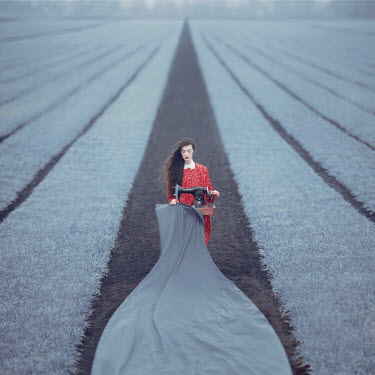 Oleg Oprisco WOMAN WITH SEWING MACHINE IN FIELD Women
