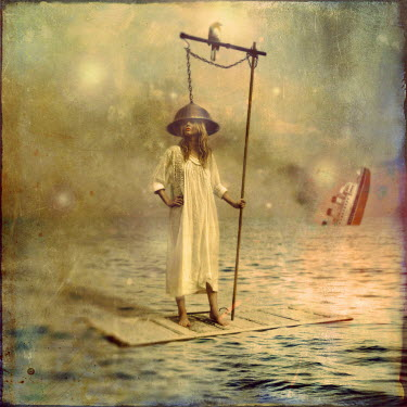 Kamil Vojnar SURREAL IMAGE OF WOMAN ON RAFT IN SEA Women