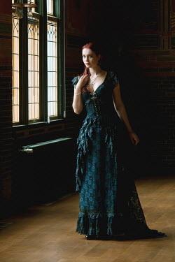 Patrick Den Drijver WOMAN IN DRESS BY LEADED WINDOW Women