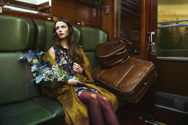 Lidia Vives Rodrigo WOMAN ON TRAIN WITH LUGGAGE AND FLOWERS Women