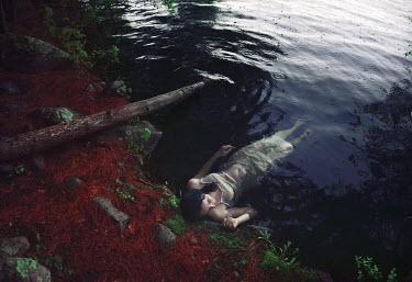 Sarah Ann Loreth WOMAN'S BODY BY EDGE OF WATER Women