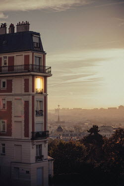 Maren Becker PARISIAN BUILDING WITH LIGHT AT WINDOW Specific Cities/Towns