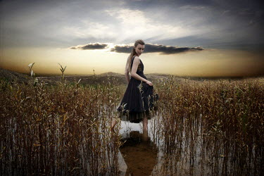 Selina De Maeyer GIRL STANDING IN MARSH AT SUNSET Women