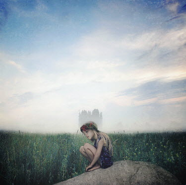 Kylli Sparre LITTLE GIRL ON ROCK IN FIELD Children