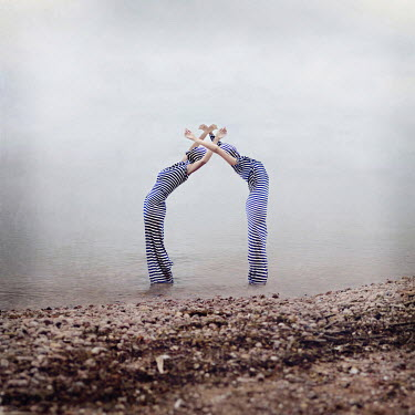 Kylli Sparre WOMAN COVERED IN STRIPED MATERIAL ON BEACH Groups/Crowds