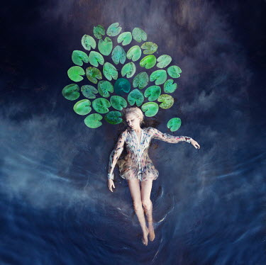 Kylli Sparre WOMAN FLOATING IN WATER SURROUNDED BY LEAVES Women