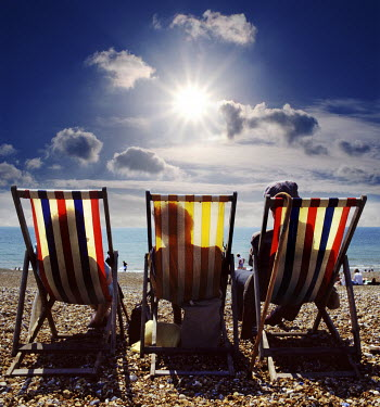 Adrian Leslie Campfield THREE PEOPLE IN DECK CHAIRS ON BRIGHTON BEACH Groups/Crowds