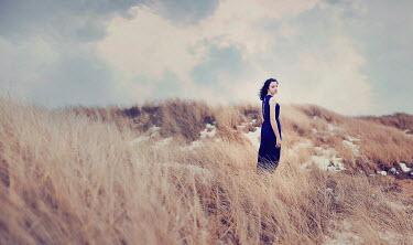 Sarah Ann Loreth WOMAN STANDING IN SAND DUNES Women