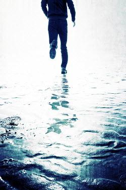 Tim Robinson MAN RUNNING OVER WET SAND Men