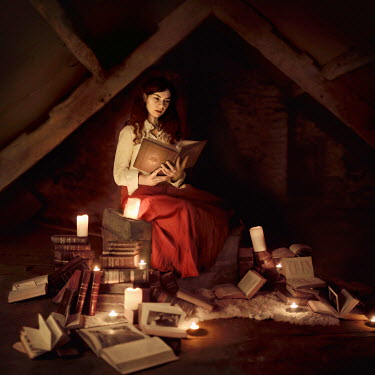 Rosie Anne Prosser WOMAN READING IN ATTIC WITH CANDLES Women