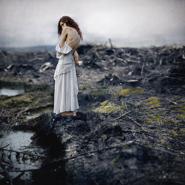 Rosie Anne Prosser WOMAN STANDING IN BLEAK MARSHLAND Women