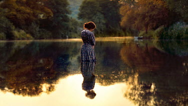 Rosie Anne Prosser WOMAN STANDING IN CALM LAKE Women