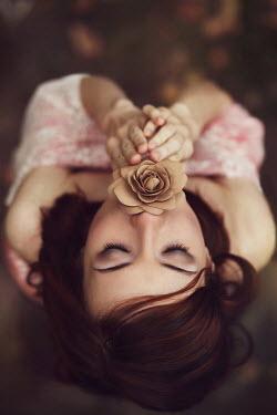 Irina Brana DARK HAIRED GIRL LYING WITH FLOWER Women