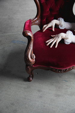 Elisa Lazo de Valdez WOMANS HANDS PLACED ON RED VELVET CHAIR Women