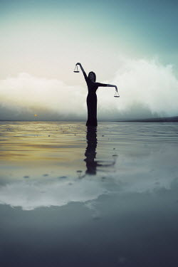 Nilufer Barin SURREAL WOMAN STANDING IN WATER HOLDING SCALES Women