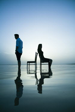 Nilufer Barin COUPLE WITH CHAIRS IN WATER Couples