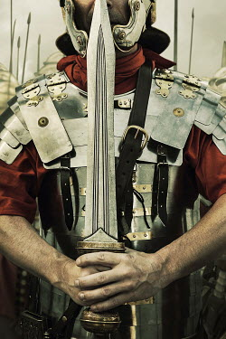 Stephen Mulcahey ROMAN CENTURION HOLDING SWORD IN ARMOUR Men