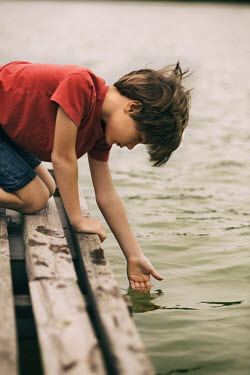 Krasimira Petrova Shishkova BOY DIPPING HAND IN LAKE ON DOCK Children