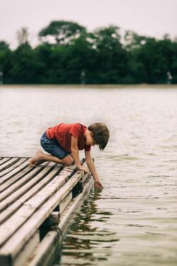 Krasimira Petrova Shishkova BOY TOUCHING WATER ON DOCK Children