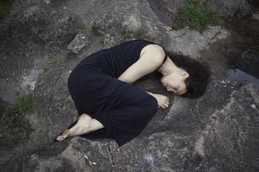 Marta Bevacqua BRUNETTE WOMAN IN FOETAL POSITION Women