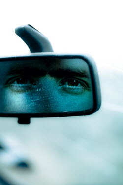 Tim Daniels MANS EYES REFLECTED IN REAR VIEW MIRROR Men