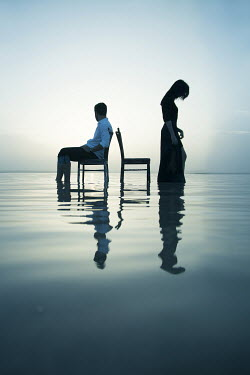 Nilufer Barin MAN SITTING AND WOMAN STANDING IN WATER Couples