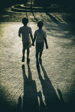 Mohamad Itani TWO LITTLE BOYS HOLDING HANDS IN STREET Children