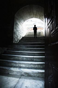 Yolande de Kort SILHOUETTE OF MAN STANDING ON STEPS Men