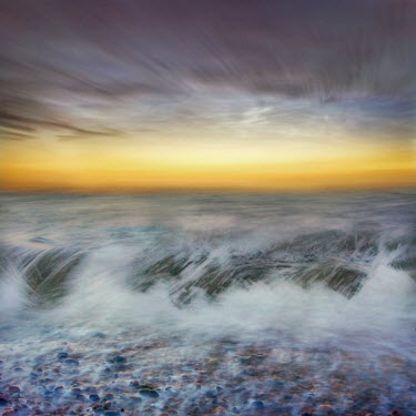 Adrian Leslie Campfield WAVES CRASHING ONTO PEBBLE BEACH AT DAWN Seascapes/Beaches